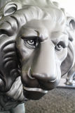 Close up of gray lion sculpture. Extreme close up on face of beautiful and strong gray lion sculpture outdoors on concrete Royalty Free Stock Photos