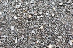 Close up of gray macadam stones on ground. Background and texture concept - close up of gray macadam stones on ground Stock Photos