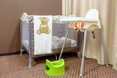 Gray portable baby bed Royalty Free Stock Images
