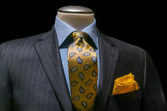 Gray Striped Jacket, Blue Shirt, Patterned Yellow Tie & Handkerc. Close-up of a gray striped jacket with blue shirt, patterned golden yellow tie and handkerchief stock photo