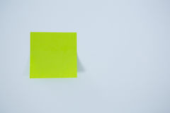Close-up of green adhesive note Royalty Free Stock Images