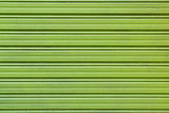 Close up Green Alloy Shutter Door background texture Royalty Free Stock Images