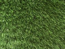 Close Up of Green Artificial Grass Textures Background Stock Photo