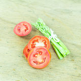 Close up green asparagus and slice tomato Stock Photos