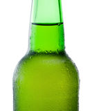 Close-up of a green beer bottle with condensation on white backg Royalty Free Stock Image