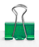 Close up of a green binder clip Stock Image