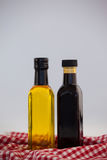 Close up of green and black olive oil in bottle on napkin Royalty Free Stock Image