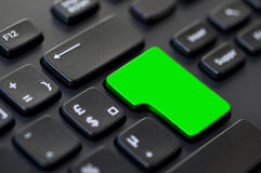 Close up of a green blank return key on a black computer Stock Photography