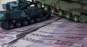 Close up green and blue tank toy placed on euro banknotes pile. business and economy war. new world war from business and economy. Concept. Concept of expense Royalty Free Stock Photos