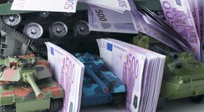 Close up green and blue tank toy placed on euro banknotes pile. business and economy war. new world war from business and economy. Concept. Concept of expense Stock Photos