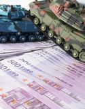 Close up green and blue tank toy placed on euro banknotes pile. business and economy war. new world war from business and economy. Close up green and blue tank Stock Photography
