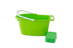 Close-up of green bucket with cleaning sponge Royalty Free Stock Image