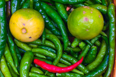 Close up of Green Chilli Peppers and lemon Royalty Free Stock Photography
