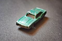 Close up of green coloured destroyed toy car. Close up of green coloured destroyed toy car, with black background stock photography