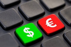 Close up of green dollar and red euro on a computer Royalty Free Stock Image