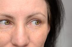 Close up on the eyes of a woman looking left royalty free stock photography