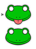 Close-up of green frog masks over white background Stock Photo