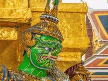 Close up Green Giant Lift golden Pagoda in Wat Phrakaew temple Bangkok Thailand stock images