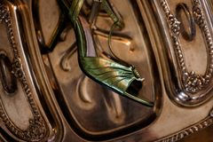 HIgh heels sit on an antique silver tray royalty free stock photography