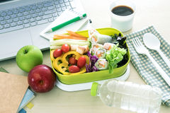 Close up the green Lunch box on work place of working desk , Stock Images