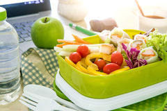 Close up the green Lunch box on work place of working desk , Stock Photography