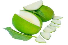Close up of green mangoes and green leaves isolated on a white background stock images