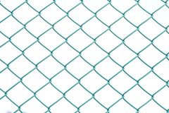 Close up green metal fence on white isolated background. Knot background texture stock photos