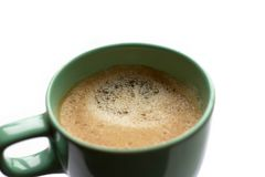 Close up green mug cup of coffee on a white background Royalty Free Stock Photography