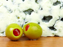 Close-up of green olives and blue cheese. Stock Photography