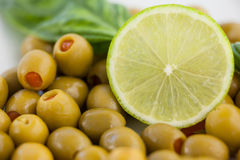 Close up of green olives with lemon stock photo