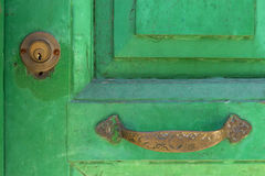 Close-up of green painted door with metal ornate doorhandle and Stock Photography