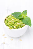 Close-up of green pea pesto with mint on a white background Royalty Free Stock Photo