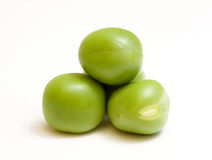 Close-up of green peas on white. Heap of four green peas isolated on white background Royalty Free Stock Image