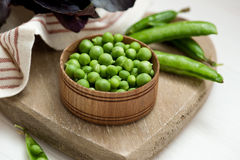 Close-up of green peas on wooden background Stock Image