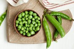 Close-up of green peas on wooden background Stock Photography