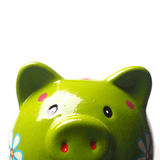Close up of a green piggy bank. Funny green piggy bank on a white background Stock Images