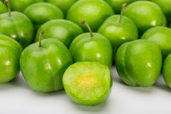 Close Up Of Green Plums Or Greengage showing the flesh and the s stock photo