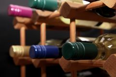Close up of green screw top wine bottle with other bottles in a Stock Images
