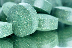 Close-up of green tablets. Stock Image