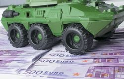 Close up green tank toy placed on euro banknotes pile. business and economy war. new world war from business and economy concept. Concept of expense and cost Royalty Free Stock Image
