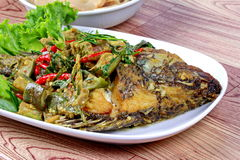 Close up of green tilapia fish curry in coconut milk. .Selective focus. Stock Photography