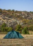 A tourist tent. Close-up green tourist tent at wild nature Stock Photos