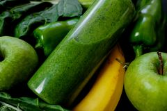 Close up Green vegetables and smoothies in a plastic bottle on b Stock Photos