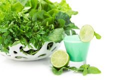 Close up of green vegetables in white bowl and cocktail royalty free stock images
