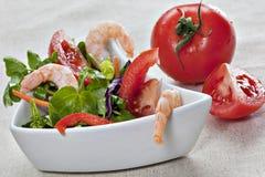 Close up of green watercress salad with tiger prawns Stock Photos