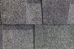 Close up grey asphalt shingle background. Grey asphalt shingle for roof work Stock Photos