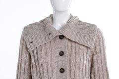Close up grey buttoned pullover for women. Close up female mannequin dressed in knitted sweater with collar Stock Photo