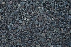 Close up grey granite gravel background. Pebble background Gravel texture. Gravel background. Stones texture. Close up grey granite gravel background. Pebble royalty free stock photo