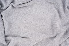 Close up grey knitted pullover background. Top view Royalty Free Stock Photography