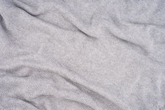 Close up grey knitted pullover background Stock Images